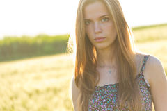Blond girl in countryside. Portrait of attractive young girl with long blond hair in summery countryside Stock Photo