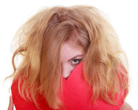 Blond girl covering face with red paper heart Royalty Free Stock Photos
