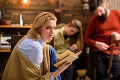 Blond girl with cunning eyes plotting something, conspiracy concept. Detective lover absorbed by favorite novel. Woman. In blue shirt, jeans and beige poncho royalty free stock photos