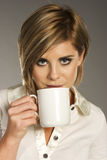 Blond girl with cup Royalty Free Stock Images