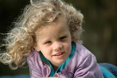 Blond girl with curly hair Royalty Free Stock Photography