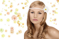 Blond girl with daisy looking at the camera Stock Photo