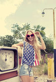 Blond girl on damaged gas station Royalty Free Stock Images