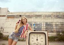 Blond girl on damaged gas station Royalty Free Stock Image