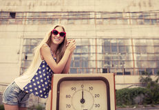 Blond girl on damaged gas station Royalty Free Stock Photos