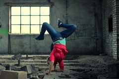 Blond girl dancing break dance in the old brickworks Royalty Free Stock Images