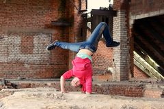 Blond girl dancing break dance in the old brickworks Stock Photos