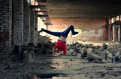 Blond girl dancing break dance in the old brickworks Stock Photography