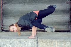Blond girl dancing break dance on the street Royalty Free Stock Photo