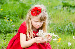 Blond girl with dandelion Royalty Free Stock Images