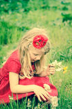 Blond girl with dandelion Stock Images