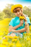 Blond girl in dandelions Stock Images