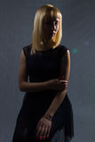 Blond girl in the dark Royalty Free Stock Image
