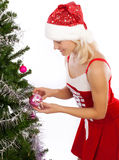 Blond girl decorating christmas tree Royalty Free Stock Photo