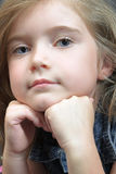 Blond girl in denim. Cute blond girl with strong eye-contact; leaning on her hands Stock Photos