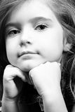Blond girl in denim - black and white. Cute blond girl with strong eye-contact; leaning on her hands Royalty Free Stock Images