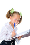 Blond girl with diary and pen Royalty Free Stock Photo