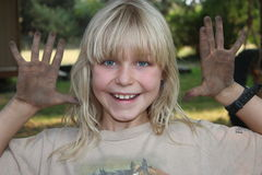 Blond Girl with Dirty Hands Stock Photography
