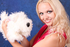 Blond girl with dog Royalty Free Stock Photo