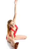 Blond girl doing gymnastic exercises Stock Images