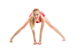 Blond girl doing gymnastic exercises Royalty Free Stock Image