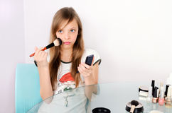 Blond girl doing makeup Royalty Free Stock Photo