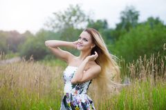 Blond girl in dress  on a meadow Stock Photo