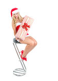 Blond girl dressed as Santa Claus Royalty Free Stock Images