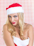 Blond girl dressed as Santa Claus Stock Photos