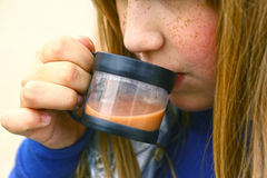 Blond girl drink cacao close up photo. Preteen blond girl drink cacao close up photo Stock Photography