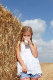 Blond girl drinking milk Royalty Free Stock Photography
