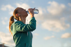 Blond girl drinking water after sport activities Royalty Free Stock Photo