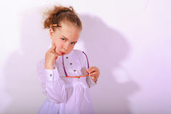 Blond girl with ear piece in the mouth Stock Photography