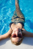 Blond girl enjoying the water in pool Royalty Free Stock Photo