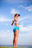 Blond girl exercise Royalty Free Stock Photos