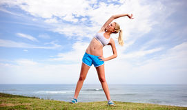 Blond girl exercises Royalty Free Stock Image