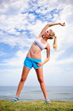 Blond girl exercises Royalty Free Stock Photos