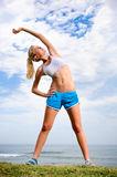 Blond girl exercises Stock Photography