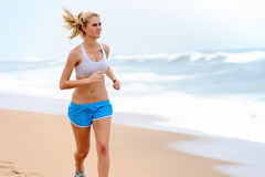 Blond girl exercises Royalty Free Stock Images