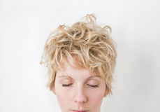 Blond Girl Eyes Closed - VERY Mixed Hairs ! looking Down. Blond Girl Eyes Closed - VERY Mixed Hairs royalty free stock photo