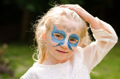 Blond girl with face-painting stock photography