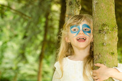 Blond girl with face-painting stock photo