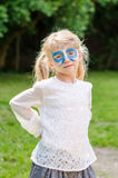 Blond girl with facepainting royalty free stock image