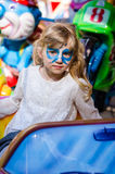 Blond girl with facepainting royalty free stock photography