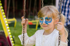 Blond girl with facepainting royalty free stock photo