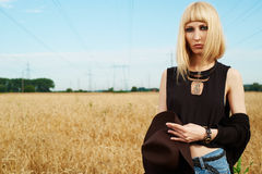 Blond girl in the fields Stock Photography