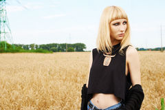 Blond girl in the fields Royalty Free Stock Photo