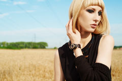 Blond girl in the fields Royalty Free Stock Photos