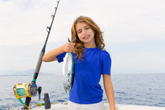 Blond girl fishing bluefin tuna trolling sea. Blond girl fishing bluefin tuna trolling in Mediterranean sea catch and release Royalty Free Stock Photography