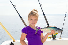 Blond girl fishing bonito Sarda tuna trolling sea Stock Images